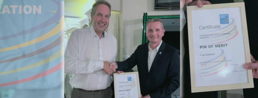 IKF_awards_Pin_of_Merit_to_Piotr_Urbanski_POL